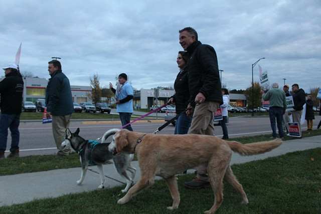 Phil Scott arrives in South Burlington with wife Diana and their dogs, Denali and Tucker. - PAUL HEINTZ
