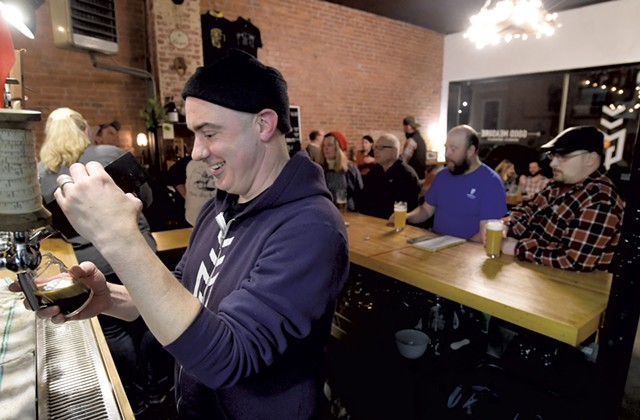 Scott Kerner pouring a beer at Good Measure Brewing - JEB WALLACE-BRODEUR