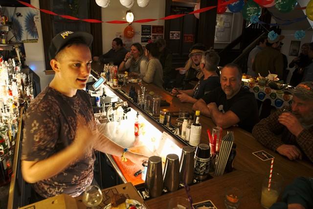 Owen Daniel-McCarter schmoozing with patrons at Babes Bar in Bethel - DYLAN KELLEY