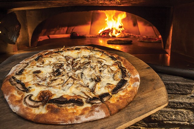 Wild mushroom with caramelized onions and gooey mozzarella pizza at Depot62 - TOM MCNEILL