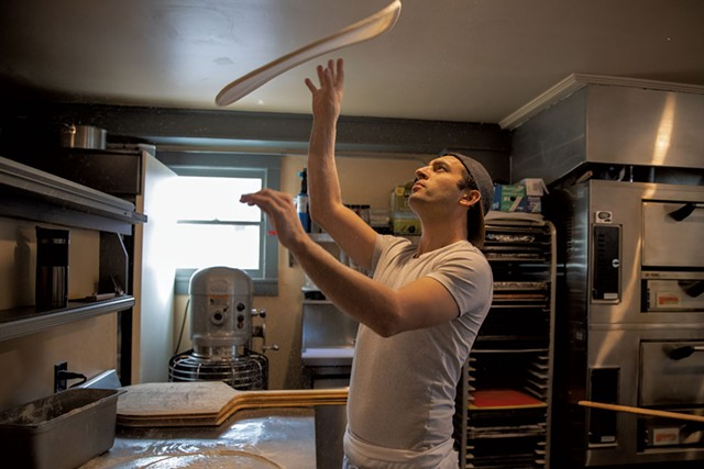Co-owner Tyler Stratton tossing dough - JAMES BUCK
