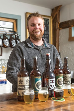 Dan Foley of Foley Brothers Brewery stands at the tasting counter. - OLIVER PARINI