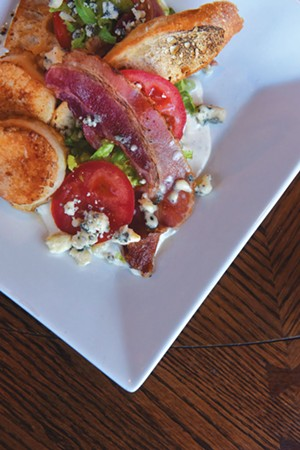 """A BLT salad, with romaine, """"VT Smoke & Cure"""" bacon, bleu cheese dressing and crostini at the Barrows House in Dorset, Vt. - SARAH PRIESTAP"""