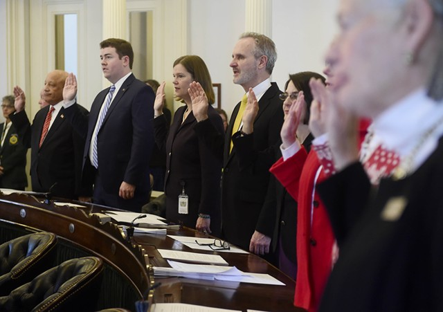Members of the Senate take their oaths of office. - JEB WALLACE-BRODEUR
