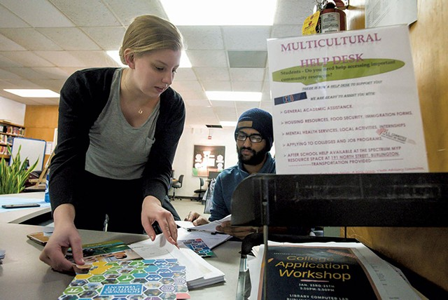 Allison Bailey of the U.S. Committee for Refugees and Immigrants Vermont (left) and Rabin Dahal of Spectrum Youth & Family Services staffing the Spectrum Multicultural Help Desk - GLENN RUSSELL