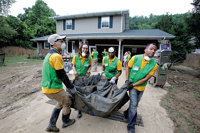 Church members cleaning up after severe flooding in West Virginia - COURTESY OF WORLD MISSION SOCIETY CHURCH OF GOD