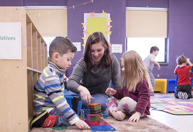 Stephanie Carvey working with kids at Rekaroo's Childcare in Rutland, Vt. - CALEB KENNA