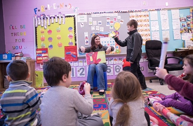 Stephanie Carvey telling a story to kids at Rekaroo's Childcare in Rutland, Vt. - CALEB KENNA