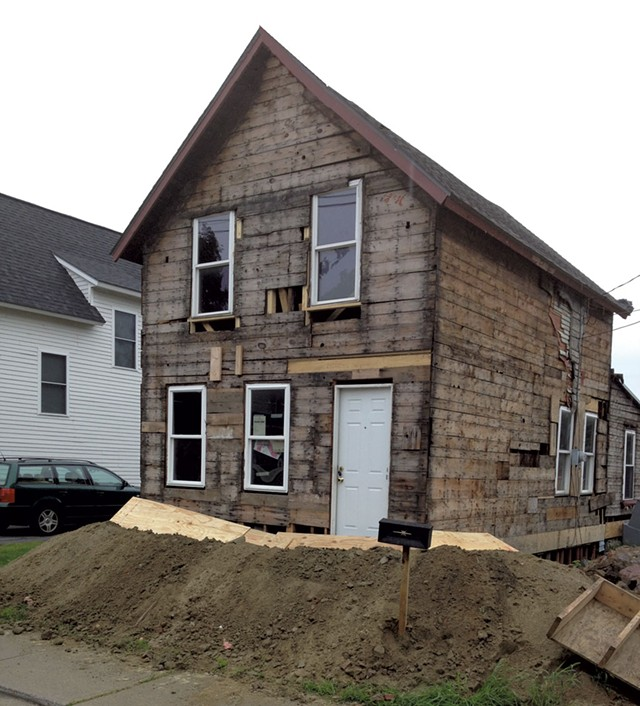 August 2014: The house is stripped back to the frame and jacked up to allow work on the basement foundation. - COURTESY OF GRAHAM MACHARG