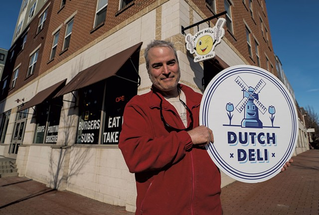 Chris West with the new Dutch Deli sign - COURTESY OF DUTCH DELI
