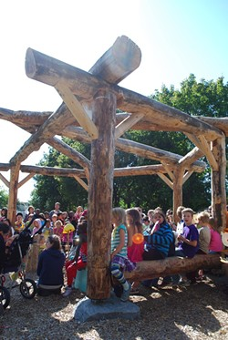 Students in the outdoor classroom at the Sustainability Academy. - FILE PHOTO