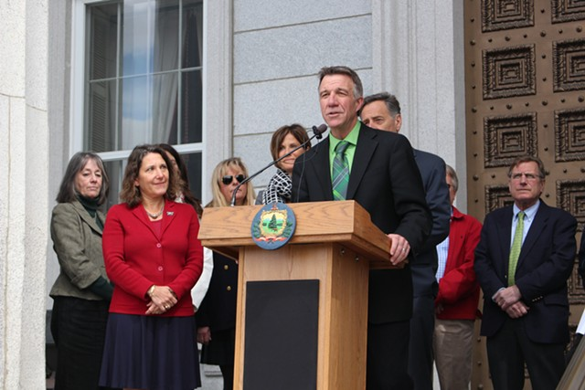 Secretary Deb Markowitz, left in red, at a Green Up Day press conference in April with Lt. Gov. Phil Scott. - FILE: PAUL HEINTZ