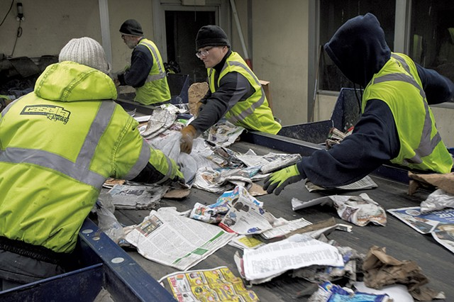 Workers sorting recycling - CALEB KENNA