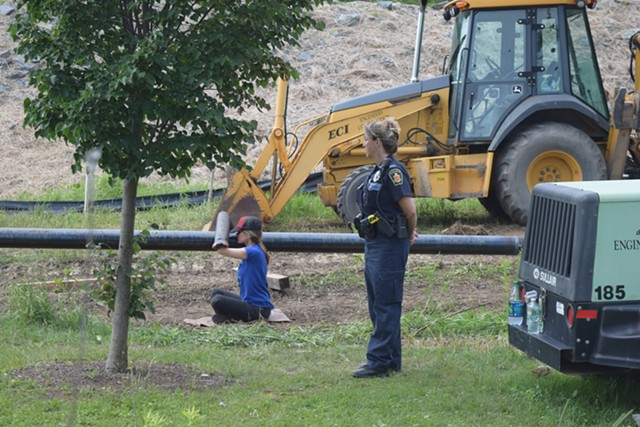 Johanna Anderson sits chained Thursday morning to a pipe at the Vermont Gas pipeline construction site in Essex. - TERRI HALLENBECK