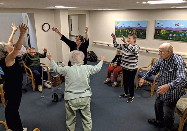Residents during an exercise class - COURTESY OF THE LIVING WELL GROUP
