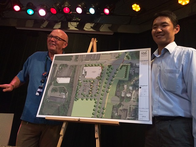 Pat Burns, left, and John Tashiro show plans for City Market's South End store. - ALICIA FREESE
