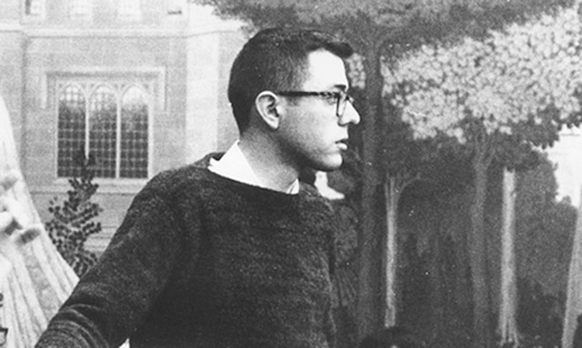 A young Bernie Sanders - attends a meeting with - civil rights activists from - the University of Chicago.