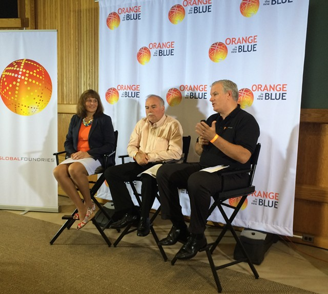 From left, GlobalFoundries executives Janette Bombardier, Mike Cadigan and Brian Harrison speak at a press conference at their Essex plant. - MARK DAVIS