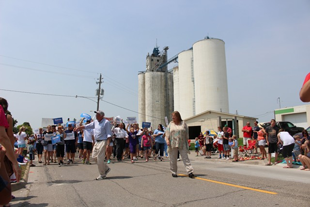 Sen. Bernie Sanders and Jane Sanders march in the Waukee, Iowa, Independence Day parade. - PAUL HEINTZ