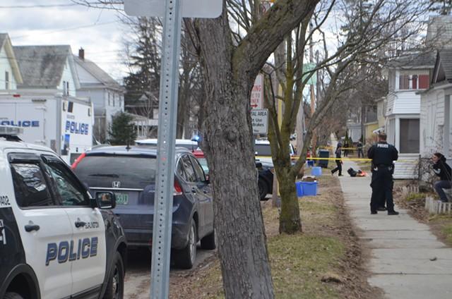 Police interview witnesses on North Willard Street. - DEREK BROUWER