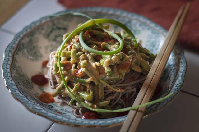 Garlic scapes in peanut sauce over noodles - HANNAH PALMER EGAN
