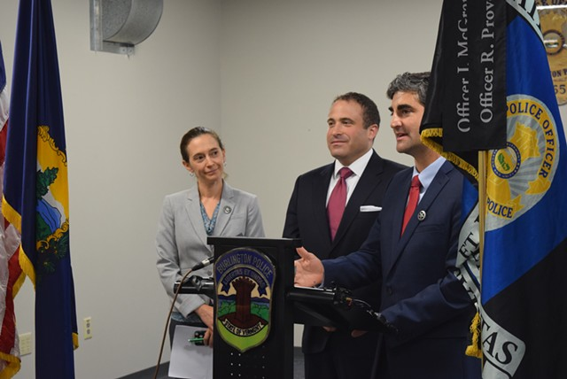 Brandon del Pozo (center) appears Tuesday at a Burlington news conference, with Mayor Miro Weinberger and Police Commission chair Sarah Kenney. - TERRI HALLENBECK
