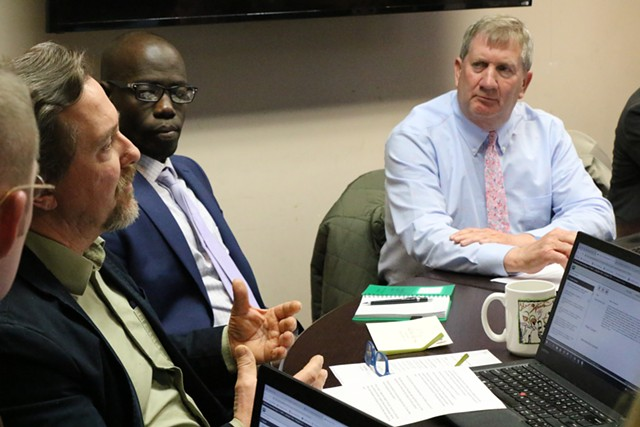 Councilor Brian Pine, left, speaks as councilors Ali Dieng, center, and Kurt Wright look on - COURTNEY LAMDIN