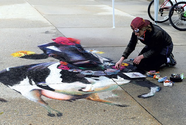 Katie Runde working on a cow chalk mural at Middlebury College - CALEB KENNA