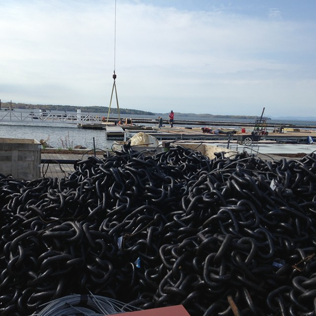 A pile of chains that will help secure the floating breakwater at the Burlington Harbor Marina - MOLLY WALSH