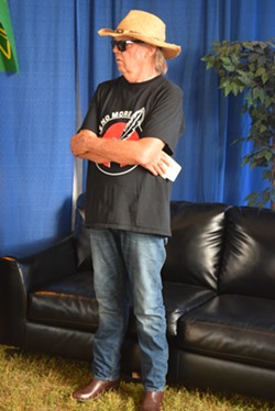 Neil Young at a news conference before his show in Essex Junction on Sunday night - TERRI HALLENBECK