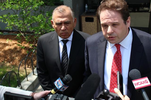 Ariel Quiros, left, with his lawyer, Seth Levine - PAUL HEINTZ