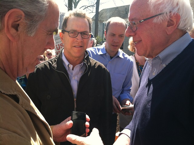 Sen. Bernie Sanders, right, campaigns for president in New Hampshire in May with campaign field director Phil Fiermonte, center. - TERRI HALLENBECK