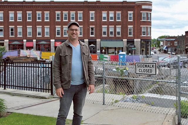 David Hohenschau in front of construction in downtown Middlebury - SABINE POUX
