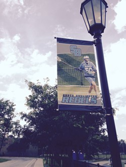 A banner on the campus of South Burlington High School, home of the Rebels - MOLLY WALSH/SEVEN DAYS