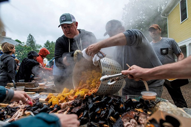 Eric Warnstedt (left) and Will McNeill (center) serving a high-country shrimp boil at 18 Elm - GLENN RUSSELL