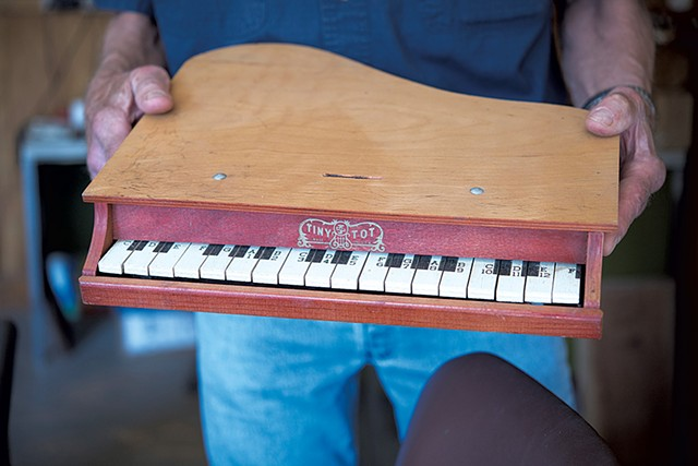 Jack Brown holds a toy piano - CALEB KENNA