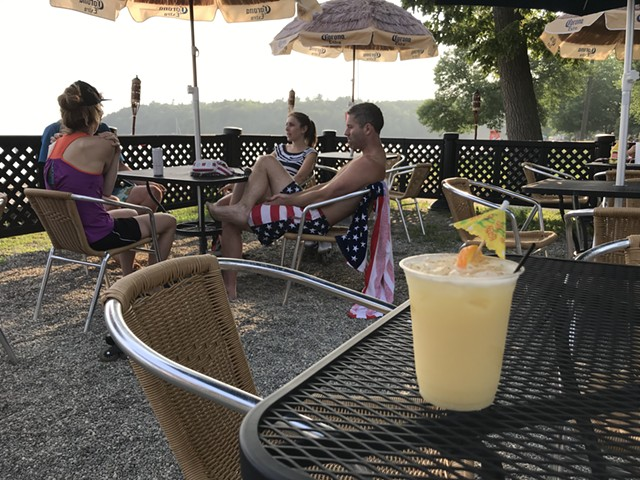 Painkiller cocktail and patrons at the Beach House at North Beach - SALLY POLLAK