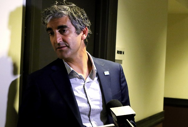 Mayor Miro Weinberger speaking to reporters Monday night - COURTNEY LAMDIN