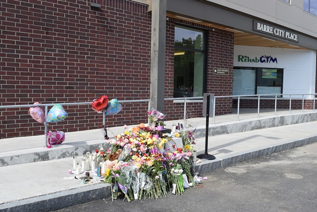 A memorial of flowers, balloons, candles and stuffed animals at the spot where Lara Sobel was shot Friday afternoon - TERRI HALLENBECK