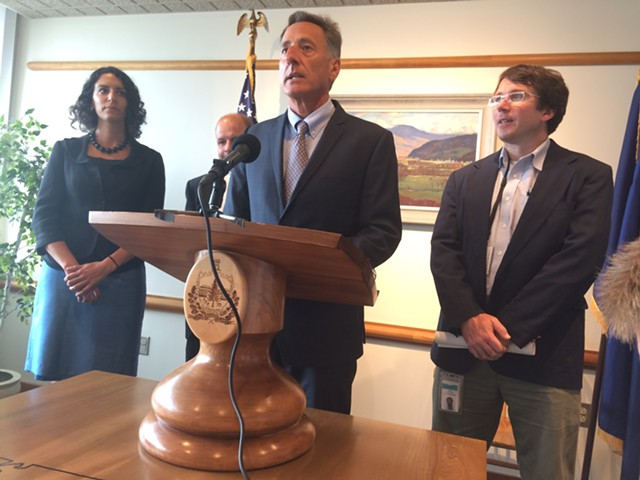 Gov. Peter Shumlin, flanked by Cassandra Gekas and Sean Sheehan, both with Vermont Health Connect, gave an update on its progress. - NANCY REMSEN