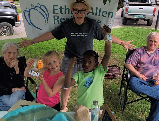 Children from the Boys & Girls Club of Burlington and residents from the Ethan Allen Residence at the Old North End Farmers Market - COURTESY OF THE LIVING WELL GROUP