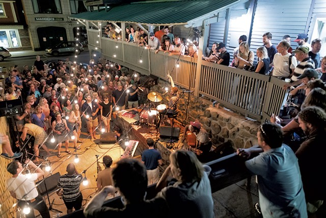 Sammy Miller and the Congregation on the patio of the Waterhole - GABE  DICKENS