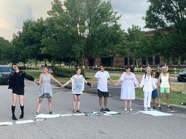 Protesters blocking the road in front of ICE's Williston intelligence center - DEREK BROUWER