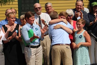 House Speaker Shap Smith hugs his son, Eli. - PAUL HEINTZ
