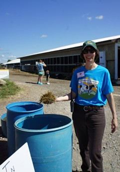 Dr. Julie Smith holding cow feed - STACEY BRANDT