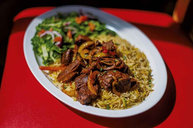 A classic Somali dish of goat and rice at Kismayo Kitchen - GLENN RUSSELL