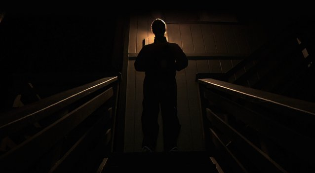 """One of the film's more effective """"accidental"""" shots: Josef tries to convince Aaron to come inside for a nightcap. - BLUMHOUSE PRODUCTIONS"""