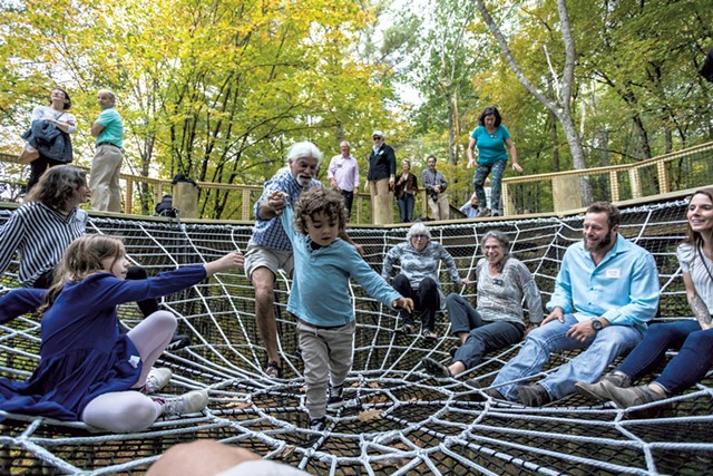 Visitors enjoying the giant spiderweb - TOM MCNEILL