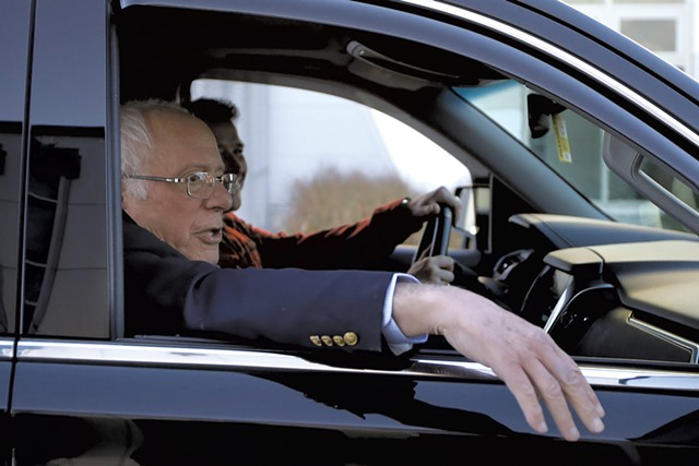 Sen. Bernie Sanders leaving Burlington International Airport Saturday - STEVEN SENNE/AP