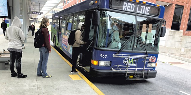 Passengers boarding at the Green Mountain Transit center in downtown Burlington - MOLLY WALSH